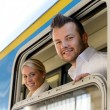 Man and woman in train looking window — Stock Photo
