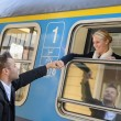 Woman leaving with train man holding hand — Stock Photo