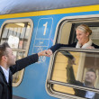Woman leaving with train man holding hand - Stockfoto