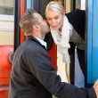 Man kissing woman goodbye on cheek train — Stock Photo #17417333