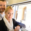 Woman and man standing by train window — Stock Photo #17417359