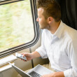 Man looking out the train window thinking - Stockfoto
