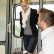 Man sitting train compartment woman getting in - Stock Photo