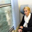 Woman sleeping in train compartment tired resting — Stock Photo