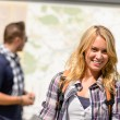 Couple backpack traveling on holiday smiling map — Stock Photo