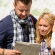 Stock Photo: Couple looking at map on city break