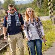 Couple walking with backpack in train station — Stock Photo