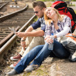 Woman resting on man's shoulder backpack travel - Stock fotografie