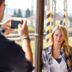 Man taking photograph of woman digital camera — Stock Photo