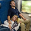 Couple sleeping in train woman man vacation - Foto Stock