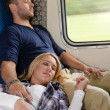 Couple resting with eyes closed in train — Stock Photo