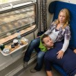Couple sleeping while traveling with train tired - 图库照片