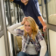 Woman and man sitting on train hall — Stock Photo
