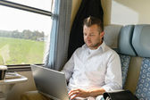 Man commuting with train using laptop travel — Stock Photo