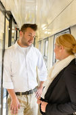 Woman and man talking on train hall — Stock Photo