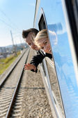 Woman man heads out the train window — Stok fotoğraf