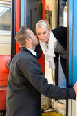 Man kissing woman goodbye on cheek train — Stock Photo