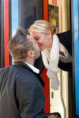 Man kissing woman goodbye train leaving romance — Stock Photo