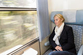 Woman asleep in train compartment tired resting — Stock Photo