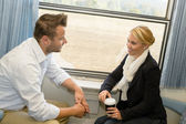 Woman and man traveling with train talking — Stock Photo