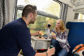 Couple enjoying sandwiches traveling with train — Stock Photo