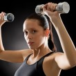 Fitness woman young sportive weights exercise - Stock Photo
