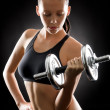 Black fitness woman young sport weights exercise - Stock Photo