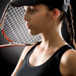 Young tennis player woman with racket - Stock Photo