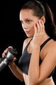 体育女青年听音乐耳机 — 图库照片