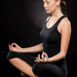 Full length of a young woman meditating - Stock Photo