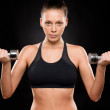 Portrait of a sporty woman lifting weights — Stock Photo