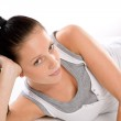 Woman lying in sportswear on white background — Stock Photo #18446495