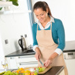 Woman cutting vegetables kitchen standing happy — Stock Photo