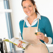 Smiling woman cooking kitchen recipe vegetables home — Stock Photo