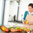 Young woman cutting vegetables kitchen preparing  — Stock Photo