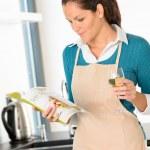 Caucasian woman preparing vegetables recipe kitchen cooking — Stock Photo #19055185