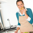 Young woman tasting preparing kitchen vegetables dinner — Stock Photo