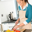 Happy woman cutting tomato kitchen preparing salad — Foto de Stock