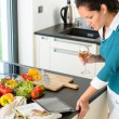Young woman reading tablet recipe kitchen cooking — Stock Photo