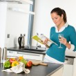 Woman housewife reading cooking book recipe kitchen — Stock Photo