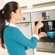 Young woman setting coffee maker machine kitchen — Stock Photo