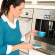 Stock Photo: Cheerful woman making coffee machine kitchen cup