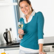 Smiling woman kitchen drinking wine preparing vegetables — Stock Photo #19055253