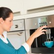 Happy woman making coffee machine kitchen cup — Stock Photo