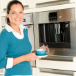 Smiling woman drinking cappuccino kitchen machine cup - Stok fotoğraf
