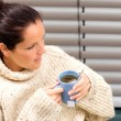 Woman drinking cup tea knitted sweater relaxing — Stockfoto