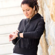 Young woman checking after exercising sport sweatsuit — Stock Photo #19055275