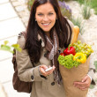 Happy woman shopping phone groceries texting vegetables — Stock Photo