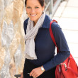 Happy businesswoman arriving home traveling luggage tired — Stock Photo