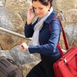 Happy woman calling hurried traveling luggage phone — Stock Photo
